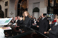 Céline Dion coming out of the Four Seasons Hotel in Paris, greeted by a huge crowd of fans - France
