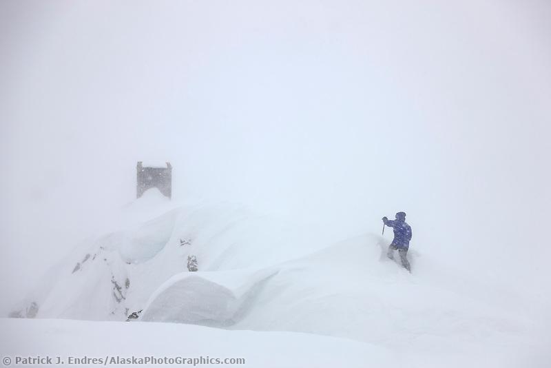 Trekking to the outhouse at the don sheldon mountain house, ruth glacier, Alaska Range, Interior, Alaska.