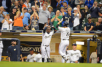Milwaukee Brewers outfielder Ryan Braun #8 congratulated by Yuniesky Betancourt #3 after hitting a home run during a game against the Los Angeles Dodgers at Miller Park on May 22, 2013 in Milwaukee, Wisconsin.  Los Angeles defeated Milwaukee 9-2.  (Mike Janes/Four Seam Images)