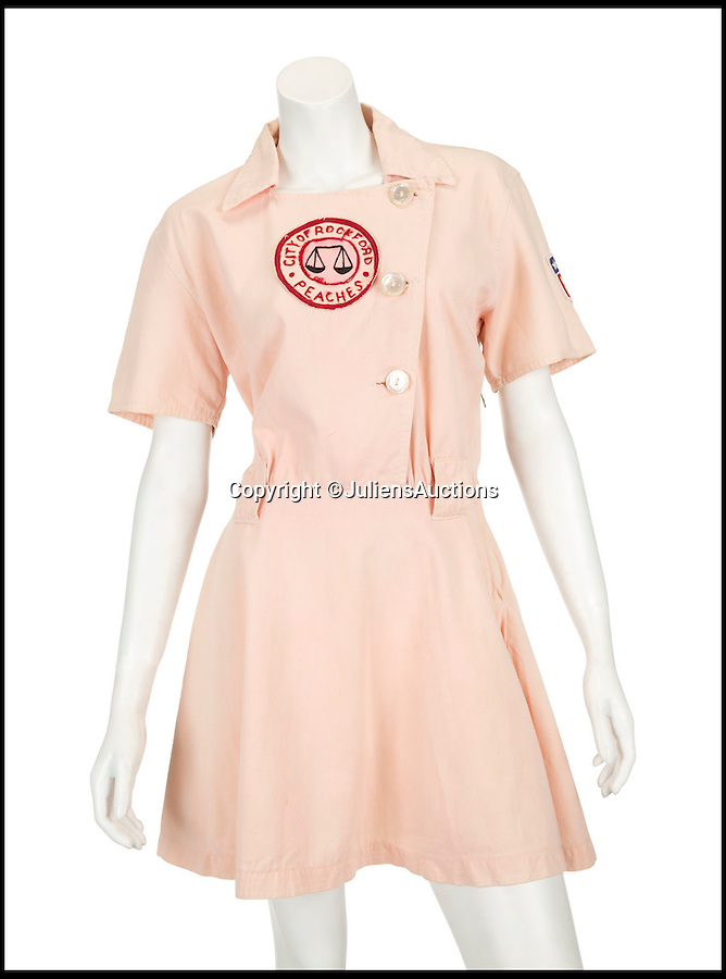 BNPS.co.uk (01202 558833)<br /> Pic: JuliensAuctions/BNPS<br /> <br /> ***Please Use Full Byline***<br /> <br /> The Rockford Peaches uniform worn by Madonna, in A League of Their Own (1992). Est, $3,000 - 5,000. <br /> <br /> A British hedge fund company is about to cash-in on a surprisingly-secure investment - Madonna.<br /> <br /> Marquee Capital was launched in 2005 looking for investors to raise a six-figure kitty to snap up celebrity memorabilia.<br /> <br /> The organisation bought more than 140 Madonna items, mostly costumes and jewellery, she wore during her movie and singing career.<br /> <br /> The goods included dozens of outfits from the 1996 hit musical Evita as well as the star's peach baseball dress and glove from her 1992 movie 'A League of Their Own' and a vest top and jeans she wore for her music video of American Pie.<br /> <br /> The sale takes place at LA-based Julien's Auctions on November 7.