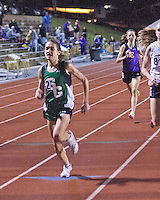 Ste. Genevieve freshman Taylor Werner sprints to the finish of the 3200 meter race to lap a Festus runner and ahead of Eureka's Hannah Long  at the Festus Tiger Town Track and Field Invitational, Tuesday, April 2, 2013, Festus, Mo. Werner won in 10:25.88 while Long  finished in 10;27.49, both top 10 times nationally, and just seconds behind the all-time best by a Missouri High School Girl.