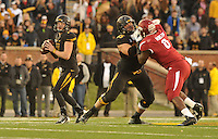 NWA Media/Michael Woods --11/28/2014-- w @NWAMICHAELW...Missouri quarterback Maty MAuk looks for an open receiver as Mitch Morse blocks Arkansas defensive end JaMichael Winston in the 4th quarter of Friday afternoons game at Faurot Field in Columbia Missouri.