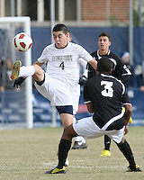 Seth C'deBaca #4 of Georgetown University kicks the ball over George Hodge #3 of Providence University during a Big East quarter-final  match at North Kehoe Field, Georgetown University on November 6 2010 in Washington D.C. Providence won 2-1.