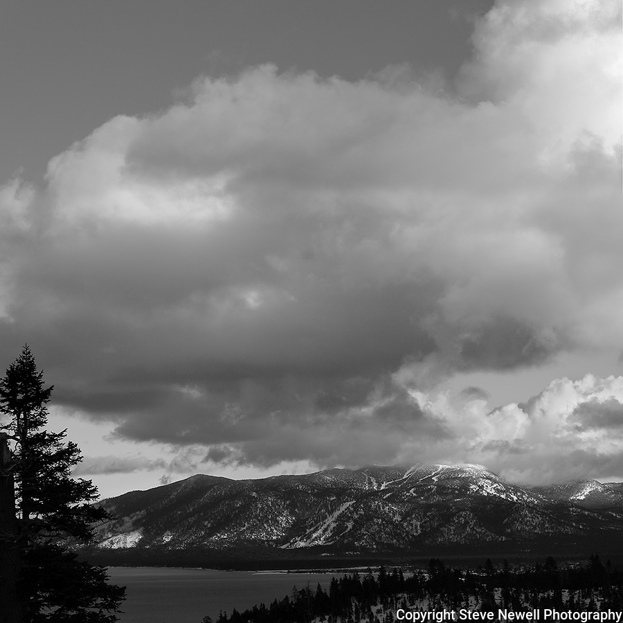 """Heavenly Tahoe""  Black and White Heavenly Ski Resort, South Lake Tahoe.  I captured this image during the month of January 2013.  The clouds were enormous and kept changing every 10 minutes.  I think I have 32GB of photos and video of this scene. South Lake Tahoe is one beautiful places to visit no matter what time of the year."