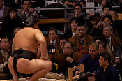 The top sumo wrestler Mongolian Hakuho pauses briefly before starting his bout.