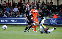 Pictured: Danny Graham of Swansea (C) marked by Adie Harris (L) takes a shot only to be saved by Neath goalkeeper lee Kendall (R). Saturday 17 July 2011<br /> Re: Pre season friendly, Neath Football Club v Swansea City FC at the Gnoll ground, Neath, south Wales.