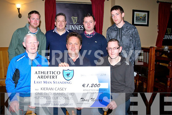 STANDING: Kieran Casey who was the overall winner of the Athletico Ardfert FC Last Man Standing  and on Friday night in McElligotts Bar he was presented with a cheque €1,200. Front l-r: Cinan Ferris, Kieran Casey and Tony Neary. Back l-r: Pa Donegan,John McElligott,Pat Sheehan and Cian Dineen.