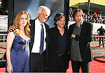 """Actress Gillian Anderson, Director/Creator Chris Carter, Writer/Producer Frank Spotnitz and Actor David Duchovny (L-R) arrive at the The World Premiere of """"The X-Files: I Want To Believe"""" at Mann's Grauman Chinese Theatre on July 23, 2008 in Hollywood, California."""