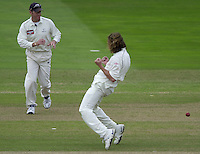 Photo Peter Spurrier.31/08/2002.Cheltenham & Gloucester Trophy Final - Lords.Somerset C.C vs YorkshireC.C..Craig White left and Ryan Sidebottom clebrate the fall of Rob turner wicket (caught white for 20 - bowled Sidebottom).