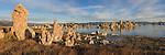 A panorama photo of Mono Lake and the tufa towers at sunrise.