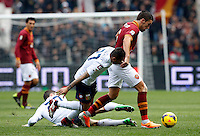Calcio, Serie A: Roma-Genoa. Roma, stadio Olimpico, 12 gennaio 2014.<br /> AS Roma midfielder Kevin Strootman, of the Netherlands, right, is challenged by Genoa midfielder Matuzalem, of Brazil, center, and defender Sime Vrsaljko, of Croatia,  during the Italian Serie A football match between AS Roma and Genoa, at Rome's Olympic stadium, 12 January 2014. <br /> UPDATE IMAGES PRESS/Riccardo De Luca
