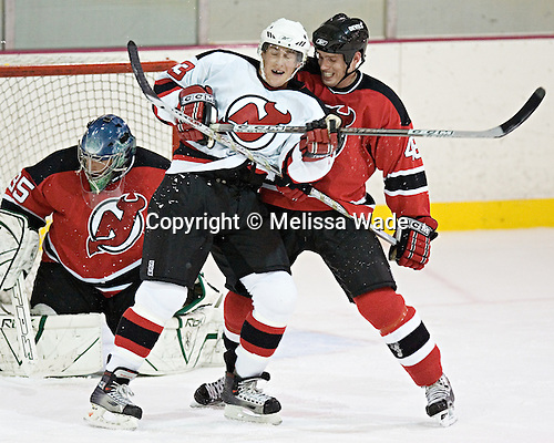 Eric Lundberg dends against Chris Minard in front of Parise. The New Jersey Devils took the ice officially for the first time at their 2006 training camp  on Friday, September 15, 2006 at their South Mountain training facility in West Orange, NJ.