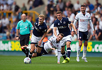 Bolton Wanderers' Adam Le Fondre is tackled by Millwall's George Saville<br /> <br /> Photographer Ashley Western/CameraSport<br /> <br /> The EFL Sky Bet Championship - Millwall v Bolton Wanderers - Saturday August 12th 2017 - The Den - London<br /> <br /> World Copyright &not;&copy; 2017 CameraSport. All rights reserved. 43 Linden Ave. Countesthorpe. Leicester. England. LE8 5PG - Tel: +44 (0) 116 277 4147 - admin@camerasport.com - www.camerasport.com