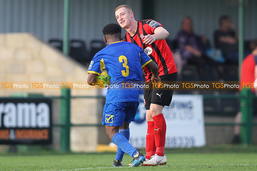 Sam Bantick tries to retrieve the match ball at the final whistle after scoreing 4 goals during Romford vs Coggeshall Town, Bostik League Division 1 North Football at Rookery Hill on 13th October 2018