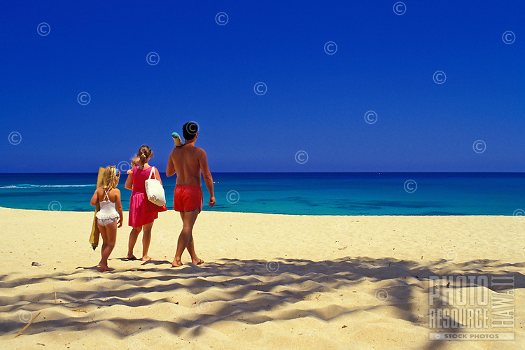 Family walking on the beach. North Shore, Oahu