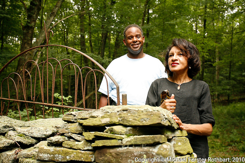 Denise Dennis and her brother Darryl Gore visit their 153-acre family homestead in Hop Bottom, PA. The Dennis Farm has been in the family for seven generations, since their ancestor Prince Perkins became one of the first free blacks to settle in Susquehanna County in 1793. <br /> <br /> Dennis hopes to restore the farm, which includes a family graveyard, original foundations and spring, and an 1859 farmhouse on Martin's Creek. However, uncertainty about natural gas drilling on adjacent properties has made finding funding impossible. Dennis herself sometimes swears she will not lease her land for drilling, but at other times wonders if revenue from gas wells could fund restoration of the property. <br /> <br /> Hydraulic fracturing or &quot;fracking&quot; is new method of drilling for natural gas: millions of gallons of water, sand and proprietary chemicals are pumped down a well under high pressure. The pressure fractures the shale, opening fissures so that natural gas can flow more freely. In August 2010, fracking is being widely used in the Marcellus Shale formation under Pennsylvania while New York considers a moratorium until the environmental effects can be reviewed. <br /> <br /> The 2005 Energy Policy Act exempted natural gas drilling from the Safe Drinking Water Act. Scientists have identified volatile organic compounds (VOCs) such as benzene, ethylbenzene, toluene, methane and xylene that have been found in contaminated drinking water near drilling sites. Other environmental concerns include surface water contamination, air pollution, forest fragmentation, plus human health problems. On the other hand, gas companies and property owners stand to earn up to one trillion dollars in profits from drilling in the Marcellus Shale.<br /> <br /> &copy; Michael Forster Rothbart<br /> www.mfrphoto.com <br /> 607-267-4893 o 607-432-5984<br /> 5 Draper St, Oneonta, NY 13820<br /> 86 Three Mile Pond Rd, Vassalboro, ME 04989<br /> info@mfrphoto.com<br /> Photo by: Michael Forster Rothbart<br /> Date: 8/2010    File#:  Canon 5D digital camera frame 70240
