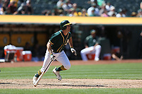 OAKLAND, CA - JULY 19:  Jaycob Brugman #38 of the Oakland Athletics bats against the Tampa Bay Rays during the game at the Oakland Coliseum on Wednesday, July 19, 2017 in Oakland, California. (Photo by Brad Mangin)