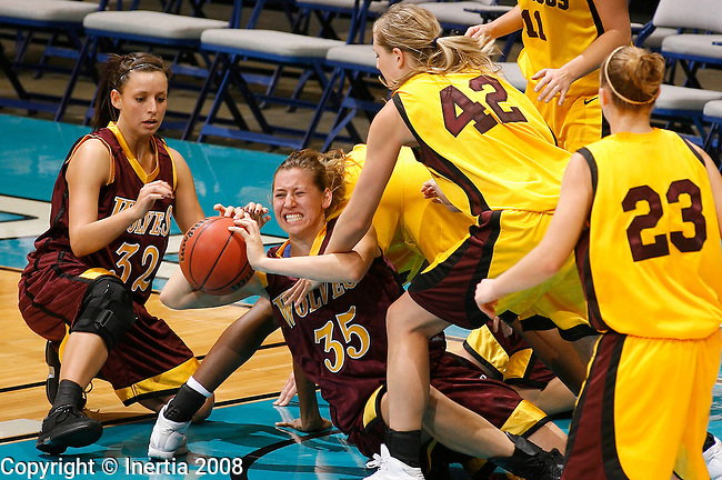 SIOUX FALLS, SD - November 29, 2008 --   Mikayla Barondeau #35 of Northern State battles for control of the ball with Kelsey Hewitt #42 of Minnesota - Duluth during their game at the NSIC Holiday Hoopfest Saturday at the Sioux Falls Arena. Also pictured are Monica Mayry #23 of UMD and Megan Kusler #32 of NSU. (Photo by Dick Carlson/Inertia)