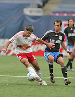 New York Red Bulls' Claudio Reyna (10) moves the ball and holds off San Jose Earthquakes' Joe Vide (6) in the first half of an MLS soccer match at Giants Stadium in East Rutherford, N.J. on Sunday, April 27, 2008. The Red Bulls defeated the Earthquakes 2-0.