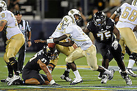 17 September 2011:  FIU defensive line Andre Pound (75) pursues UCF quarterback Jeff Godfrey (2) in the fourth quarter as the FIU Golden Panthers defeated the University of Central Florida Golden Knights, 17-10, at FIU Stadium in Miami, Florida.