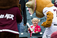 A young fan reacts to the Missouri State mascots, Boomer and Growl, during a game between the Wichita State Shockers and Missouri State Bears at Hammons Field on May 5, 2013 in Springfield, Missouri. (David Welker/Four Seam Images)