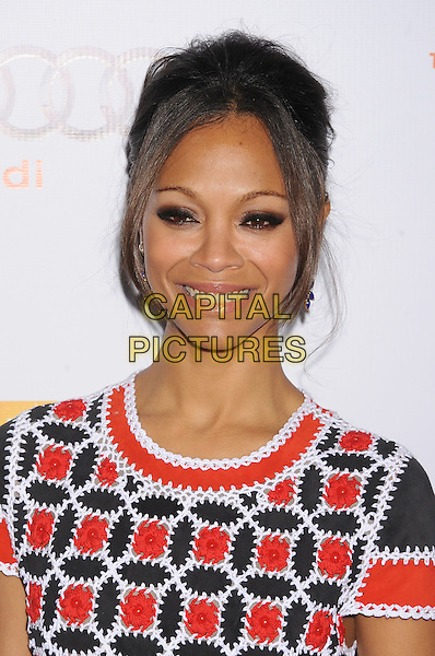 Zoe Saldana.Trevor Live at The Hollywood Palladium in Hollywood, California, USA..December 4th, 2011.headshot portrait white black red print .CAP/ROT/TM.©Tony Michaels/Roth Stock/Capital Pictures