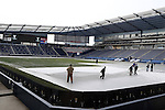 06 December 2013: Grounds crew pull up the tarps before Real Salt Lake took the field for a training session. Major League Soccer held media availability for both teams at Sporting Park in Kansas City, Kansas one day before Sporting Kansas City played Real Salt Lake in MLS Cup 2013.