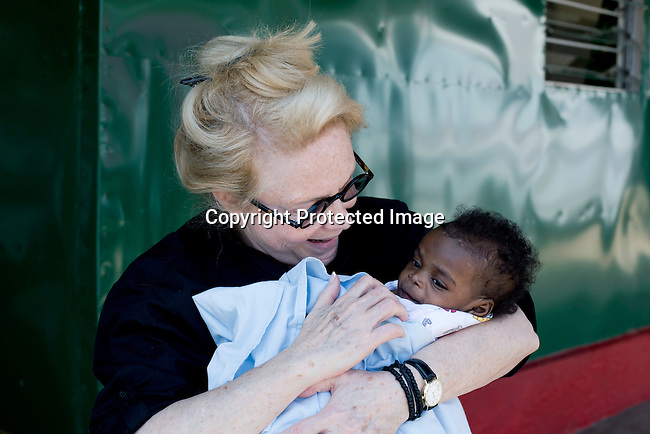 KAMPALA, UGANDA: Mary Fisher, an Aids activist, author and artist holds a baby during a workshop in Kampala, Uganda. Mary Fisher is infected with HIV-Aids and held a passionate speech at the Republican Convention in 1992 speaking about Aids.