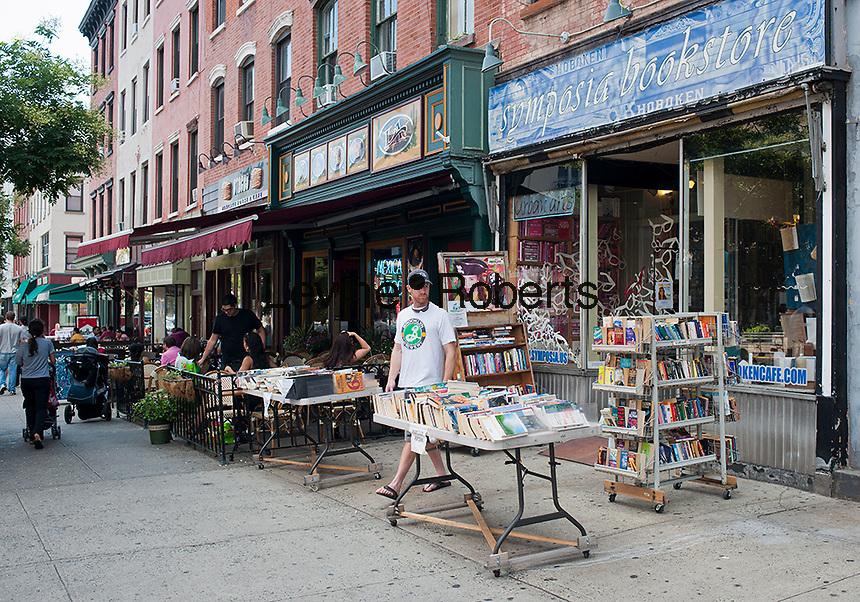 Used books and sidewalk cafes on Washington Street in Hoboken, New Jersey on Saturday, July 21, 2012. (© Richard B. Levine)