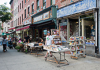 Used books and sidewalk cafes on Washington Street in Hoboken, New Jersey on Saturday, July 21, 2012. (© Richard B. Levine)
