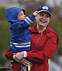 Nancy Fairbrother of Rockville Centre and son, John, 2, line up on Merrick Avenue to cheer on Long Island Marathon runners on Sunday, May 1, 2016.