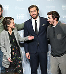 Tatiana Maslany, Jake Gyllenhaal and Jeff Bauman attend the 'Stronger' photo call during the 2017 Toronto International Film Festival at Tiff Bell Lightbox on September 9, 2017 in Toronto, Canada.