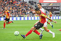 20191102 – Lens , France : Florian Sotoca (7) of Lens pictured in a duel with Matthieu Saunier (20) of Lorient during a French Ligue 2 soccer game between Racing Club de Lens and FC Lorient , a football game on the 13th matchday in the French second league, on saturday 2 nd of November 2019 at the Stade Bollaert Delelis in Lens , France . PHOTO SPORTPIX.BE   DAVID CATRY