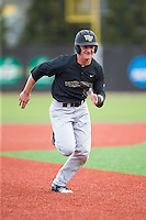 Drew Freedman (5) of the Wake Forest Demon Deacons hustles towards third base against the Charlotte 49ers at Hayes Stadium on March 16, 2016 in Charlotte, North Carolina.  The 49ers defeated the Demon Deacons 7-6.  (Brian Westerholt/Four Seam Images)