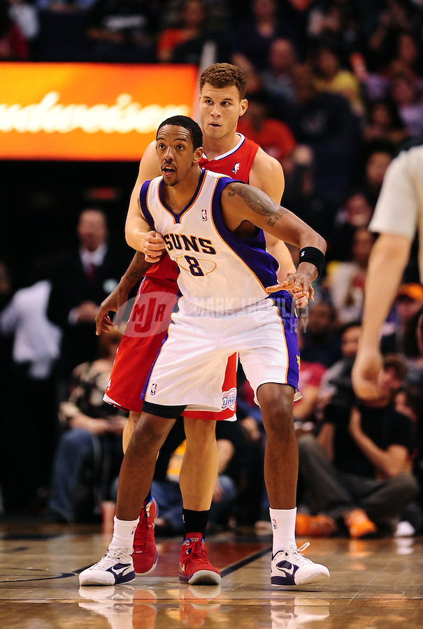 Mar. 2, 2012; Phoenix, AZ, USA; Los Angeles Clippers forward Blake Griffin (back) holds Phoenix Suns center Channing Frye at the US Airways Center. The Suns defeated the Clippers 81-78. Mandatory Credit: Mark J. Rebilas-USA TODAY Sports