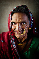 An elderly tribal woman poses for a photograph in the Dardaturki village in the Tonk District of the Northern Indian state of Rajasthan on the 5th of April 2011.
