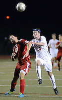 FRANCONIA, PA - NOVEMBER 11: Fleetwood's Christian Custodio #47 and Holy Ghost Prep's Jake Weimar #4 chase after a loose ball in the first half of the District One Class AA semifinal soccer playoff game at Souderton High School November 11, 2014 in Franconia, Pennsylvania.  (Photo by William Thomas Cain/Cain Images)