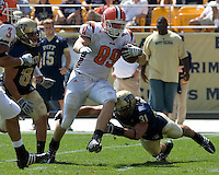 Bowling Green tight end Jimmy Scheidler (#89) avoids the tackle of Pitt defensive back Dom DeCicco (#31). The Bowling Green Falcons defeated the Pitt Panthers 27-17 on August 30, 2008 at Heinz Field, Pittsburgh, Pennsylvania.