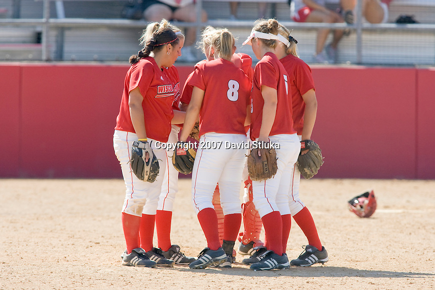 MADISON, WI - OCTOBER 6: The infield of the Wisconsin Badgers softball team huddles against UW-Parkside at the Goodman Softball Complex in Madison, Wisconsin on October 6, 2007. The Badgers beat UW-Parkside 5-4. (Photo by David Stluka).