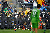 Carlos Ruiz (20) of the Philadelphia Union celebrates scoring with manager Peter Nowak during a Major League Soccer (MLS) match against the Seattle Sounders FC at PPL Park in Chester, PA, on April 16, 2011.