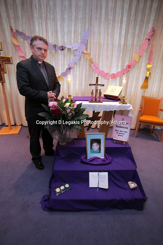 Pictured: A book of rememberance and tributes have been set at Archbishop McGrath Catholic School where Rebecca Aylward was a pupil by her headteacher Rev Dr Philip Manghan (pictured), although the school is closed for half term. Wednesday 27 October 2010<br /> Re: South Wales Police are investigating the murder of fifteen year old Rebecca Aylward from Maesteg, whose body was discovered in woods in Aberkenfig near Bridgend south Wales. A fisteen year old man who cannot be named for legal reasons has appeared at Bridgend Magistrates court this morning.