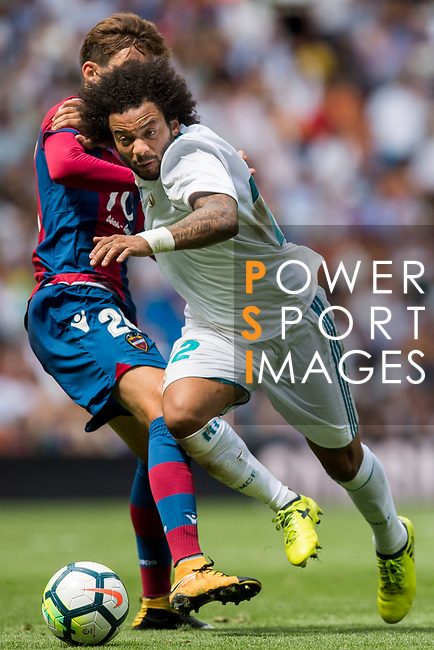 Marcelo Vieira da Silva Junior of Real Madrid (R) fights for the ball with Jose Gomez Campana of Levante UD (L) during the La Liga match between Real Madrid and Levante UD at the Estadio Santiago Bernabeu on 09 September 2017 in Madrid, Spain. Photo by Diego Gonzalez / Power Sport Images