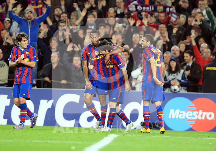 Lionel Messi celebrates scoring the first goal during the UEFA Champions League quarter final second leg match between Barcelona and Arsenal at Camp Nou on April 6, 2010 in Barcelona, Spain.