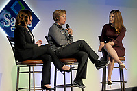 NWA Democrat-Gazette/DAVID GOTTSCHALK Julie Cromer Peoples (left), associate vice chancellor for athletics at the University of Arkansas, and Alyssa Orange (right), television sports reporter, listen Wednesday, March 28, 2018, to Shauna Estes-Taylor, head women's golf coach at the University of Arkansas, at The First Tee Girls on Course: Tee Up Your Future; An Expo for Young Women at the Sam's Club Corporate Offices in Bentonville. The expo, presented by Walmart NW Arkansas Championship presented by P&G, hosted 500 seventh through 12th grade students from area schools. Students had the opportunity to listen to an assortment of executives throughout multiple industries, while also learning how to be successful in the future using The First Tee 9 Core Values.