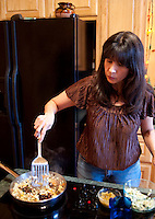 Vegan food enthusiast Mireya Mata (cq) cooks a vegan enchilada casserole at her home in Valley View, Texas, Feb. 23, 2010. The casserole was made with organic vegetables including onions, beans, corn, chiles, mushrooms, and olives...PHOTO/ Matt Nager