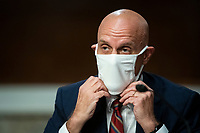 Stephen Hahn, Commissioner, United States Food and Drug Administration (FDA), adjusts a face covering during a Senate Health, Education, Labor and Pensions Committee hearing in Washington, D.C., U.S., on Tuesday, June 30, 2020. Top federal health officials are expected to discuss efforts to get back to work and school during the coronavirus pandemic.<br /> Credit: Al Drago / Pool via CNP /MediaPunch