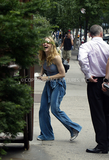 Madonna was seen going to New York Health & Racquet Club under heavy guard of 6 bodyguards and police motorcycle. Madonna arrived in high spirits to the club and was seen laughing. There was also a TV crew with Madonna -- perhaps to tape footage for her next reality TV show. New York, June 16, 2004. Please byline: PHILIP VAUGHAN/ACE Pictures.   .. *** ***  ..All Celebrity Entertainment, Inc:  ..contact: Alecsey Boldeskul (646) 267-6913 ..Philip Vaughan (646) 769-0430..e-mail: info@nyphotopress.com