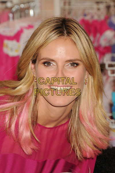 Heidi Klum.debut of her Truly Scrumptious Collection at Babies R Us in Calabasas, California, USA..14th September 2012.headshot portrait dyed hair pink sheer smiling .CAP/ROT/TM.© TM/Roth/Capital Pictures