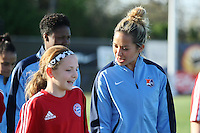 Piscataway, NJ, April 24, 2016.  Sky Blue FC midfielder, Shawna Gordon (2) chats with her escort as the team enters the field.  The Washington Spirit defeated Sky Blue FC 2-1 during a National Women's Soccer League (NWSL) match at Yurcak Field.
