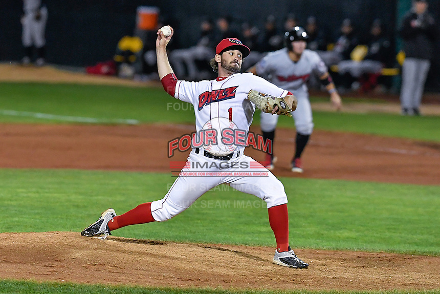 Greg Belton (1) of the Orem Owlz delivers a pitch to the plate against the Billings Mustangs in Game 2 of the Pioneer League Championship at Home of the Owlz on September 16, 2016 in Orem, Utah. Orem defeated Billings 3-2 and are the 2016 Pioneer League Champions. (Stephen Smith/Four Seam Images)